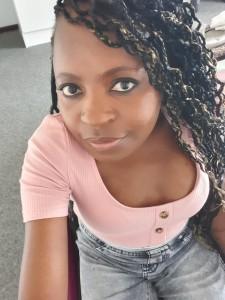 Maureen Bvuma headshot looking up into camera