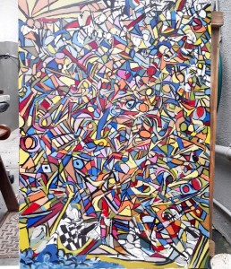 Colourful abstract painting. Predominant use of red, blue, yellow and orange with many geometric shapes