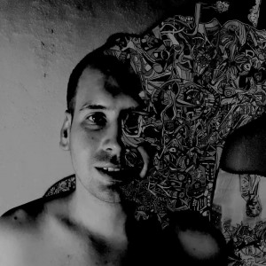 black and white portrait shot of a man. He has short hair and extending from and covering the left side of his face and head is his abstract art as if it is part of his body